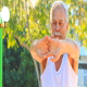Old Man Does Morning Exercises Stretches Fingers in Park - VideoHive Item for Sale