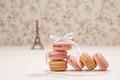 Macarons french dessert. Eiffel Tower on wood - PhotoDune Item for Sale