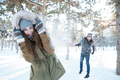 Beautiful happy couple throwing snowballs and having fun - PhotoDune Item for Sale