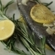 Rotating Baked Fish Seabass On a White Plate - VideoHive Item for Sale