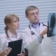 Two Doctors Examining Patients X-rays In Hospital - VideoHive Item for Sale