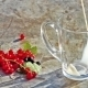 Glass Cup With Pouring Milk And Red Currants Berries In Day Light - VideoHive Item for Sale