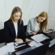 Two Women In Business Suits Working In The Office - VideoHive Item for Sale