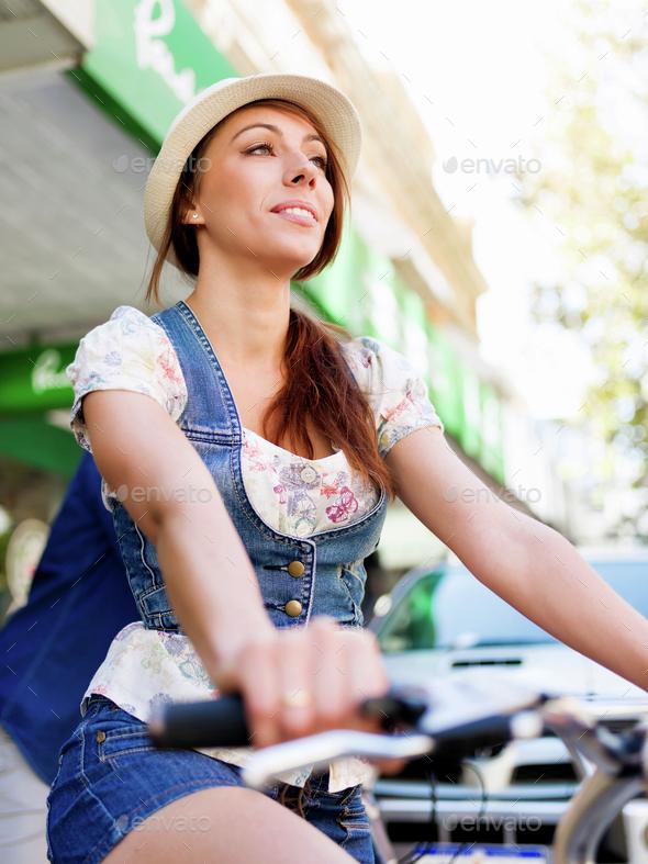 Beautiful woman riding on bike - Stock Photo - Images