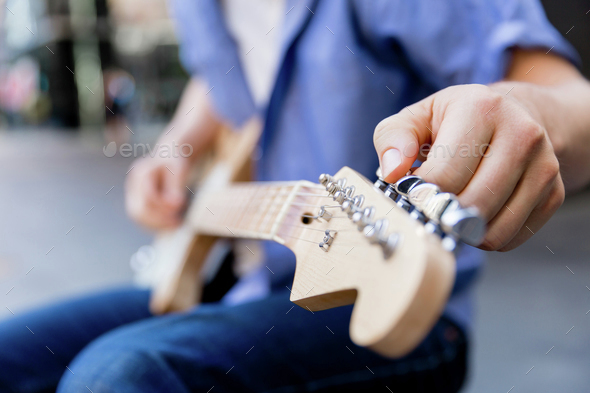 Hands of musician with guitar - Stock Photo - Images