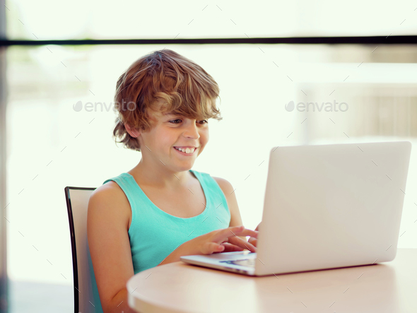 Little boy with laptop - Stock Photo - Images