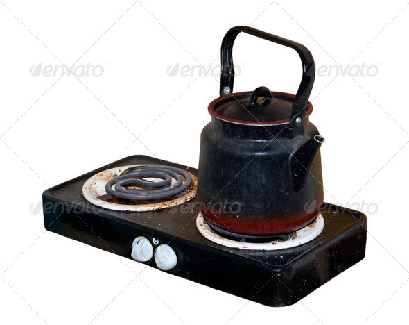 Dirty old electric stove with a kettle - Stock Photo - Images