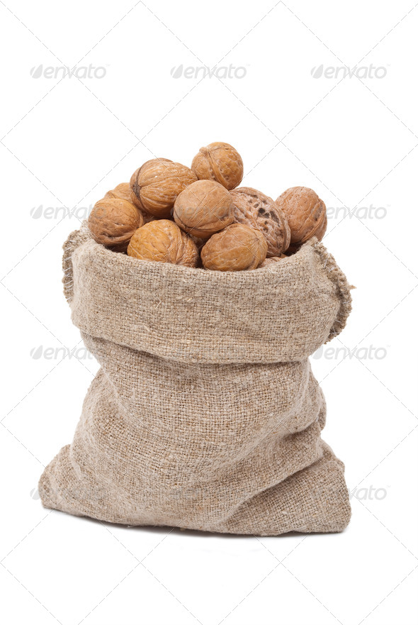 Burlap sack with walnuts - Stock Photo - Images
