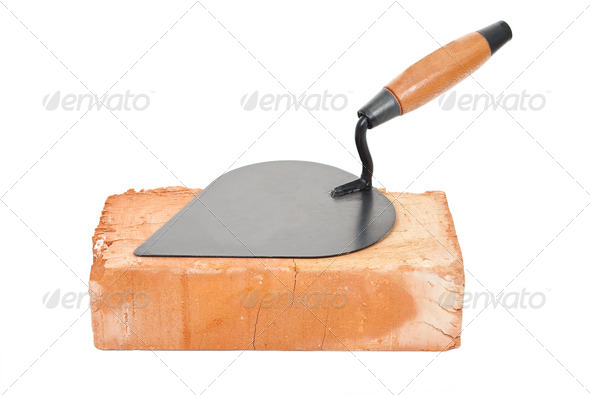 Trowel on brick - Stock Photo - Images