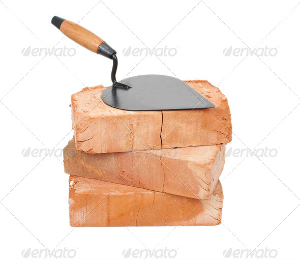 Trowel on bricks - Stock Photo - Images