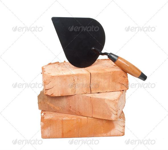 Trowel on bricks - Stock Photo - Images