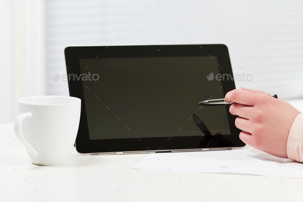 Women pointing at Tablet in a Business Meeting - Stock Photo - Images