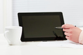 Women pointing at Tablet in a Business Meeting - PhotoDune Item for Sale