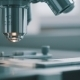 Scientist Using a Microscope In Laboratory - VideoHive Item for Sale