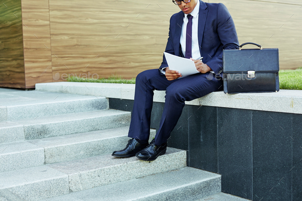 Making notes outdoors - Stock Photo - Images