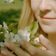 Cute Blonde Girl Touching Flowers In The Park - VideoHive Item for Sale