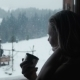 Female Has Tea Near a Window In Winter In Resort - VideoHive Item for Sale