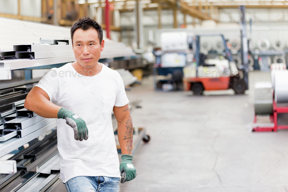 Asian worker in production plant on the factory floor - Stock Photo - Images