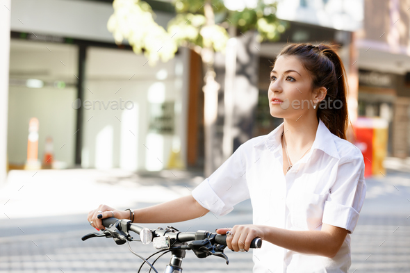 Portrait of happy young female bicyclist - Stock Photo - Images