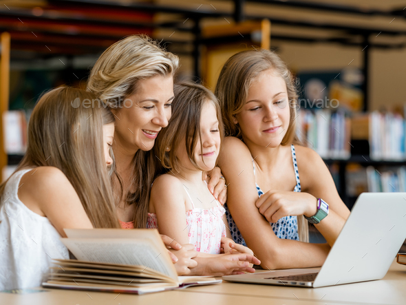 Technology and fun in the library - Stock Photo - Images