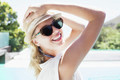 Portrait of beautiful blonde with hat and sunglasses
