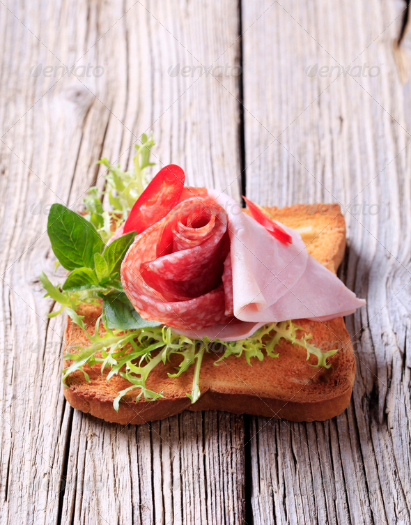 Ham and salami on toast - Stock Photo - Images