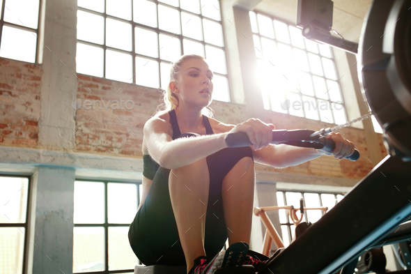 Female doing cardio workout in gym - Stock Photo - Images