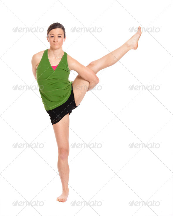 woman doing yoga, crane position - Stock Photo - Images