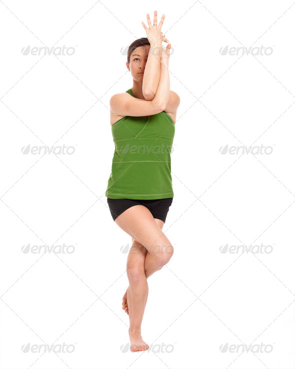 woman doing eagle position - Stock Photo - Images