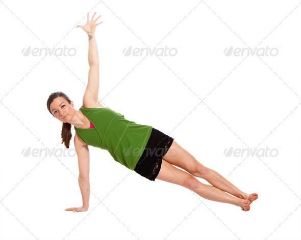 woman doing yoga, plank position - Stock Photo - Images