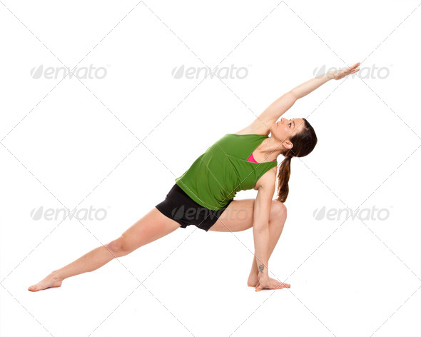 woman doing extended side angle - Stock Photo - Images