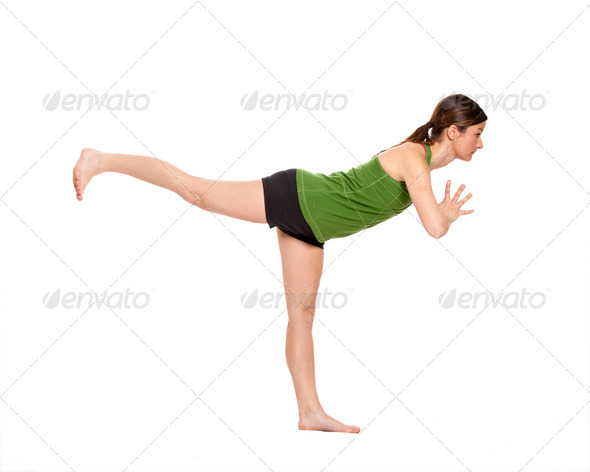 woman doing airplane position - Stock Photo - Images
