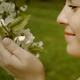 Happy Woman Touching White Flowers - VideoHive Item for Sale