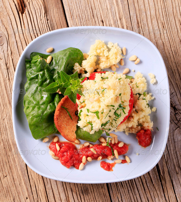 Couscous stuffed tomato - Stock Photo - Images