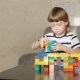 Boy Playing With Lots Of Colorful Plastic Blocks Indoor - VideoHive Item for Sale