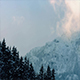 Vapor Catching Sunlight Near Snowy Mountain - VideoHive Item for Sale