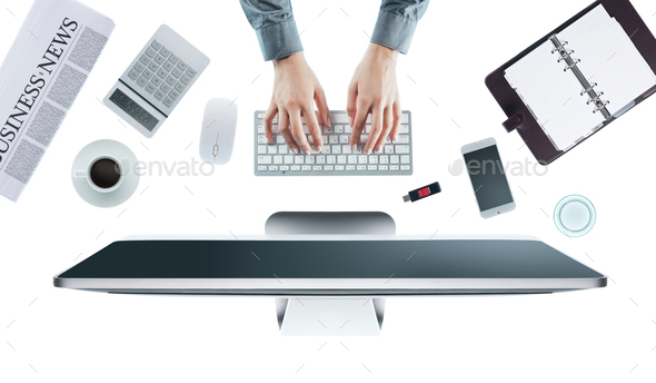 Business woman working at office desk - Stock Photo - Images