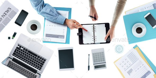 Business team checking appointment schedules - Stock Photo - Images