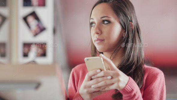 Cute girl texting with her mobile - Stock Photo - Images