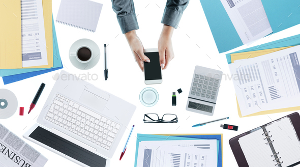 Business woman using a smart phone - Stock Photo - Images