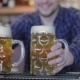 Bartender Holding Beer Glasses And Smiling - VideoHive Item for Sale