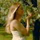 Happy Romantic Woman Between Flowers - VideoHive Item for Sale