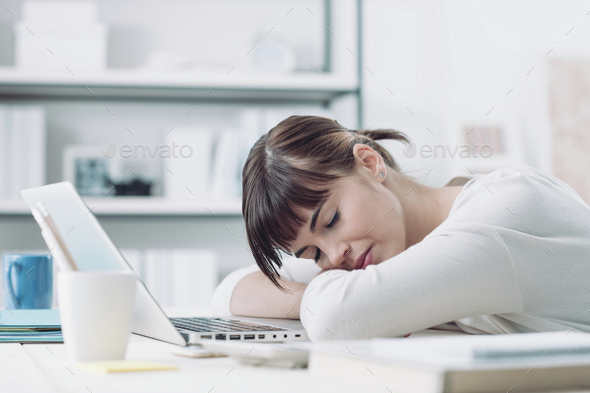 Woman sleeping on the job - Stock Photo - Images