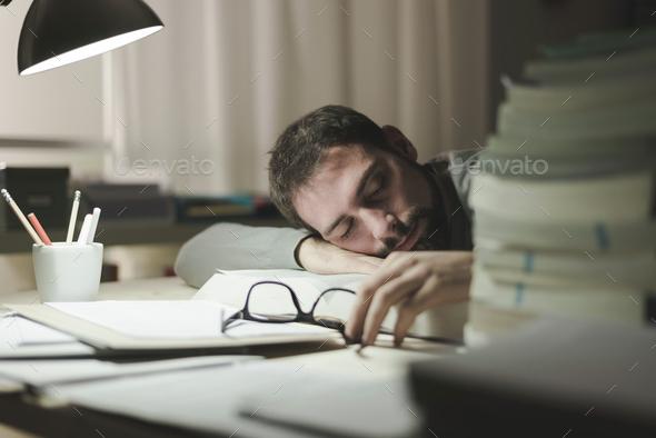 Man sleeping at his desk - Stock Photo - Images