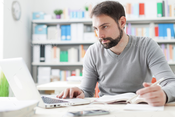 Man studying in the office - Stock Photo - Images