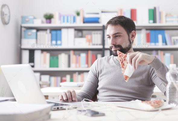 Man enjoying his lunch break - Stock Photo - Images
