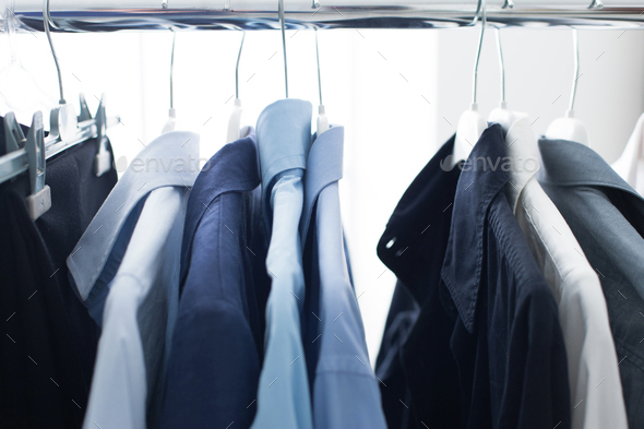 Male shirts hanging on a rack - Stock Photo - Images