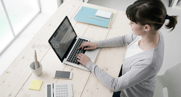 Businesswoman working with a laptop - Stock Photo - Images