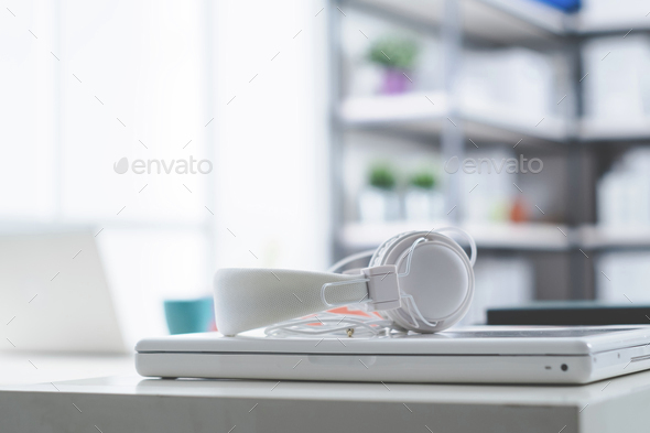 White laptop and headphones - Stock Photo - Images