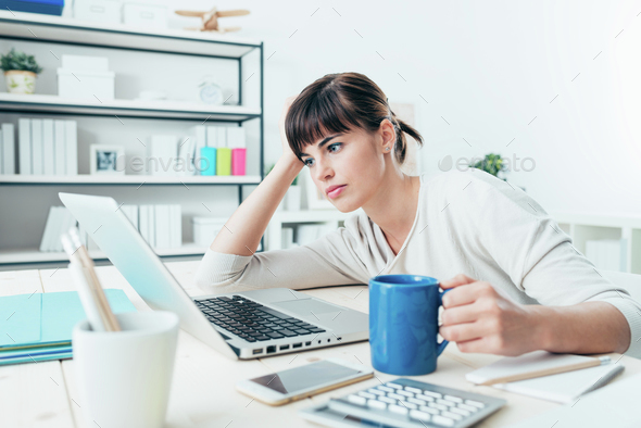 Tired woman at office desk - Stock Photo - Images